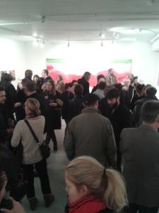 20 Painters crowd Phoenix Brighton in the main hall in front of Emily Ball's giant painting inspired by swimming pools