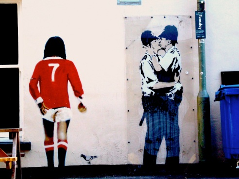 Banksy's kissing policemen on the side of the Albert pub in Brighton, England. Pic Russell Honeyman