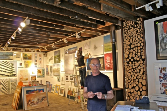 Naked Eye's David Donno (foreground) and Leah Barnett hang the show on Friday 5 September 2014