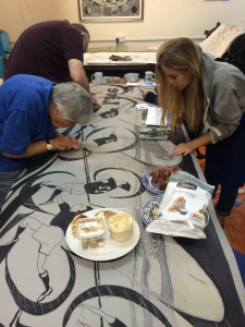 BIP members making the lino cut for the rugby world cup