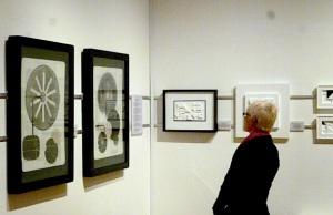 Sarah Marzaioli looking at work by Mark Charlton & Rhoda K  Baker